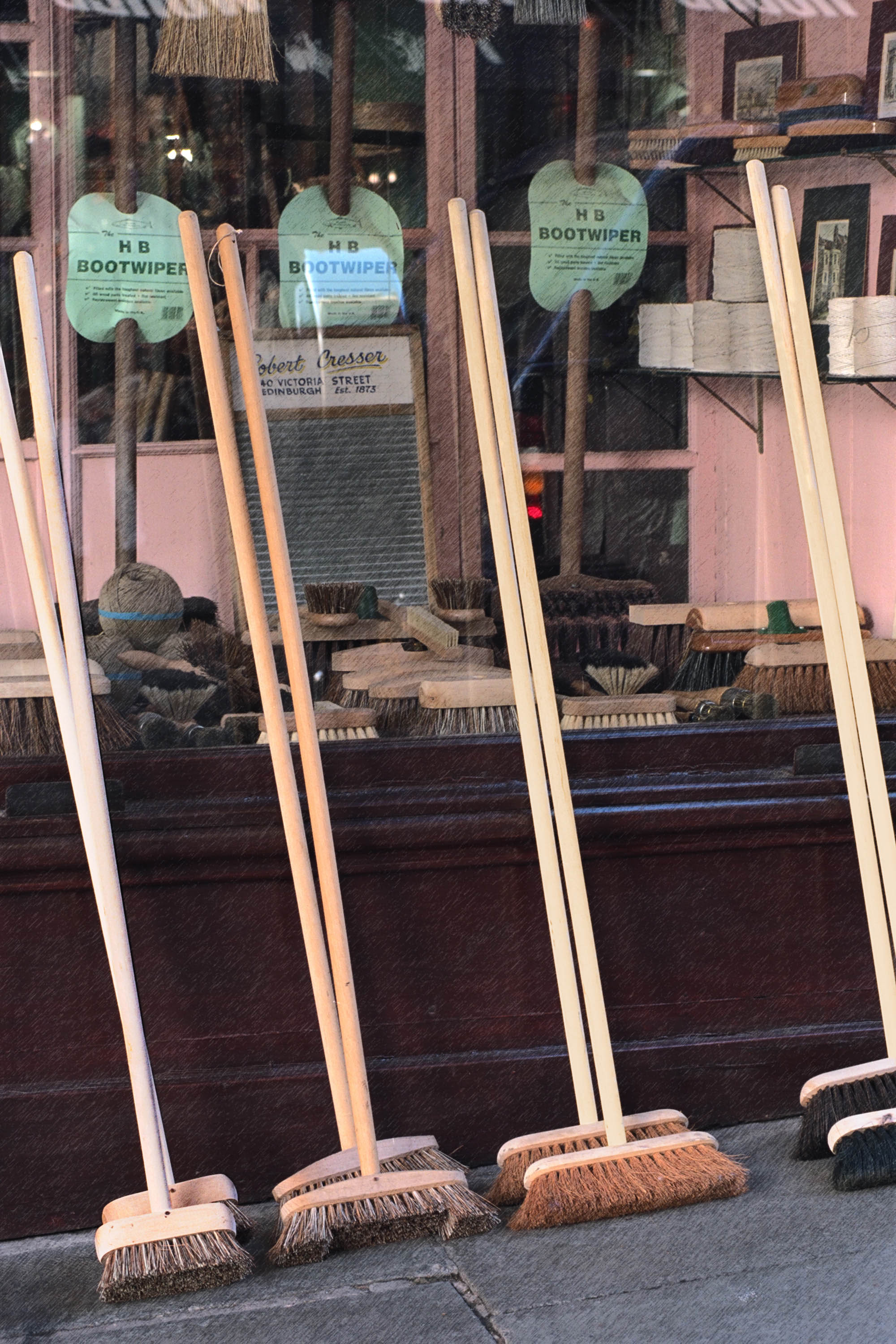 Brooms in front of store in Edinburgh, Scotland